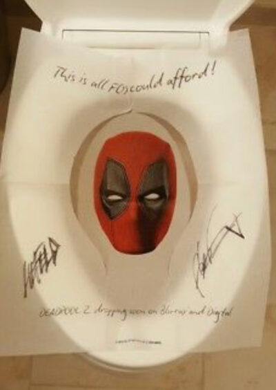 Photo of Deadpool Toilet Cover signed by Rob Liefeld.